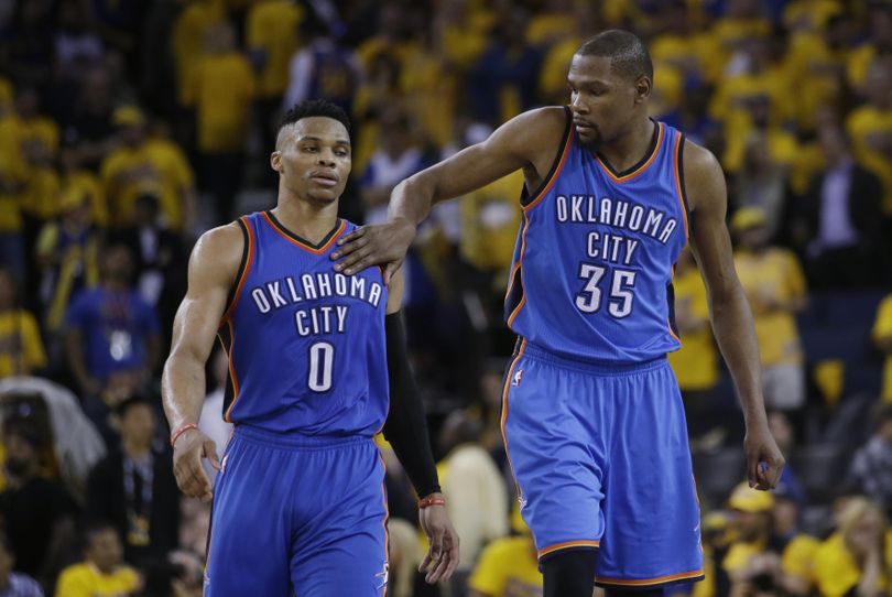 Kevin Durant (35) and Russell Westbrook led a big rally in the second half as Oklahoma City won the opening game of the NBA's Western Conference finals. (Marcio Jose Sanchez / Associated Press)