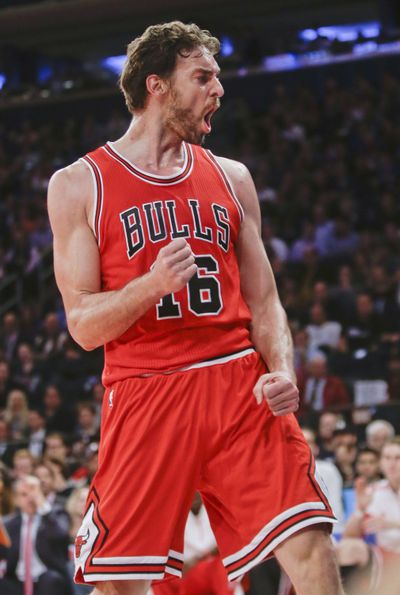 Pau Gasol, 21 points Wednesday, celebrates as his visiting Bulls spoil Derek Fisher's debut as Knicks' head coach in 104-80 rout. (Associated Press)