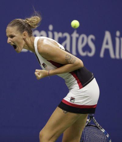 Karolina Pliskova reacts after breaking Serena Williams' serve. (Darron Cummings / Associated Press)