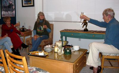From right, Harriett Jacobson, Judy Janes and Joyce Tucker offer a toast to President Barack Obama at an inauguration party Jacobson hosted at her Spokane Valley home. (Photo by Sandra Babcock / The Spokesman-Review)