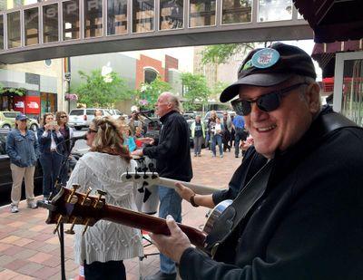 Peter Rivera, center, and Doug Clark perform on Main Avenue during Street Music Week, June 16, 2016, in downtown Spokane, Wash. (Dan Pelle / The Spokesman-Review)