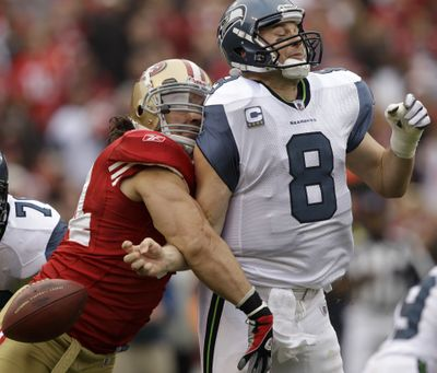 Seahawks quarterback Matt Hasselbeck fumbles as he is hit by San Francisco 49ers linebacker Travis LaBoy. (Associated Press)