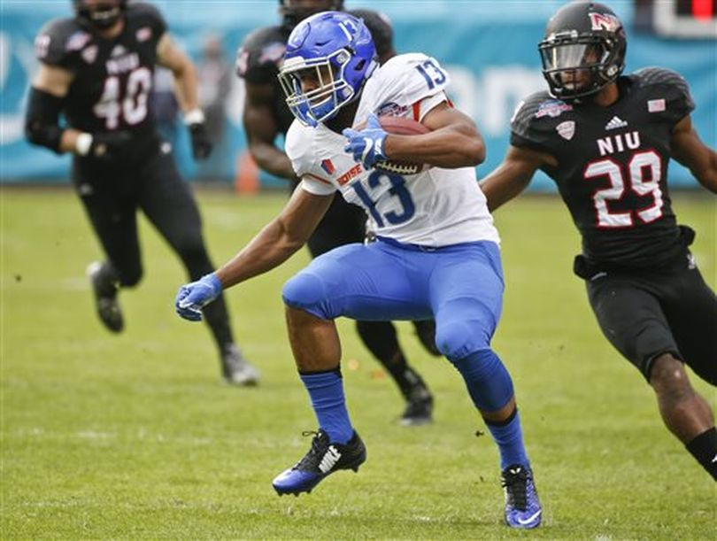 Boise State running back Jeremy McNichols maneuvers through the Northern Illinois defense with a pass reception during the first half of the Poinsettia Bowl on Wednesday in San Diego. (AP /  Lenny Ignelzi)