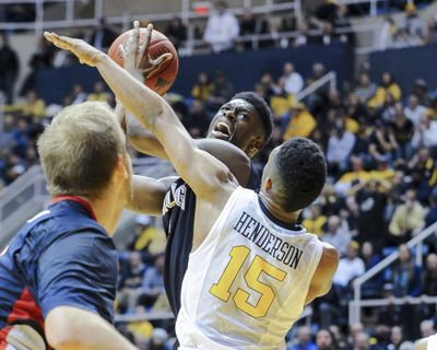 Gonzaga guard Gary Bell, Jr. looks to shoot over West Virginia's Terry Henderson (15). (AP)
