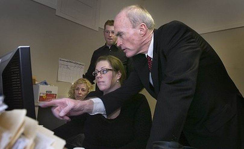Spokane Mayor Dennis Hession checks election night returns at his campaign headquarters Tuesday November 6, 2007 as his daughter Sarah pulls up the results on the computer.At back left is his wife Jane. CHRISTOPHER ANDERSON The Spokesman-Review (Christopher Anderson / The Spokesman-Review)