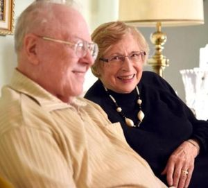 Frank and Hilde Schoonover laugh while recounting stories of their early courtship, Wednesday, Nov. 25, 2015, at their North Spokane home. The couple has been married more than 60 years. (Jesse Tinsley / The Spokesman-Review)