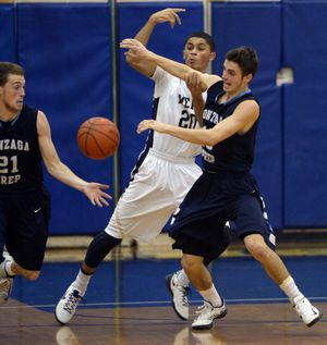 Gonzaga Prep's Brendan McClary, right, competes with Mead's Max Hess, center, for a rebound, which bounces to Gprep's Ryan Alexander, left, for the breakaway Tuesday, Dec. 17, 2013 at Mead High School. (Jesse Tinsley / The Spokesman-Review)