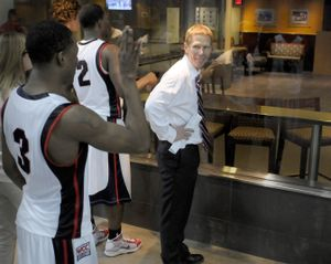 Enroute to post game media interview Demetri Goodson and Head Coach Mark Few stop to watch the replay of his game winning shot in the Portland Or. Rose Garden at the second round of the NCAA Tournament Saturday March 21, 2009.     CHRISTOPHER ANDERSON The Spokesman-Review (Christopher Anderson / The Spokesman-Review)