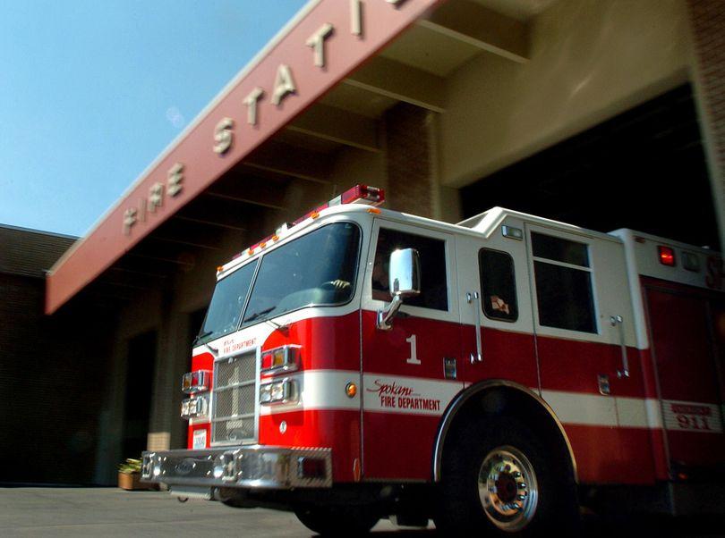 FILE - A Spokane Fire Department fire engine pulls away from Station No. 1 in downtown Spokane in August 2007. (INGRID BARRENTINE / SR)