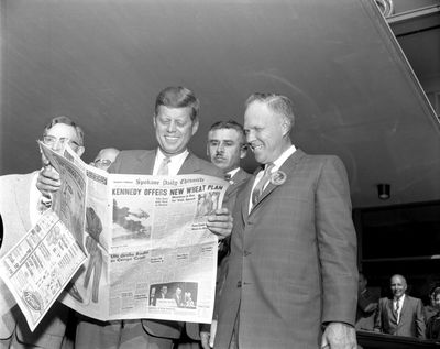 Sen. John F. Kennedy, Democratic nominee for president, looks at a Spokane Daily Chronicle on Sept. 6, 1960, during his campaign visit to Spokane.  (Spokesman-Review archives)