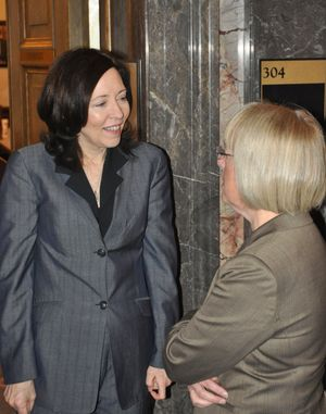 OLYMPIA -- U.S. Sens. Maria Cantwell (left) and Patty Murray meet in the wings of the state Senate on Feb. 20, 2012. Cantwell was coming out of the Senate Democratic Caucus after talking to its members and Murray was going in. They were in the state on the President's Day recess, and both stopped by the state Capitol to talk with fellow Democrats. (Jim Camden)