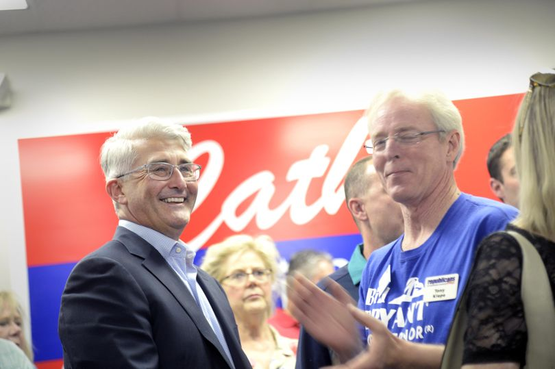 Gubernatorial candidate Bill Bryant, left, smiles as returns show him in a close race with incumbent Jay Inslee in the Washington primary election Tuesday, Aug. 2, 2016, at a party for Republican candidates and their supporters in Spokane. (Jesse Tinsley / The Spokesman-Review)