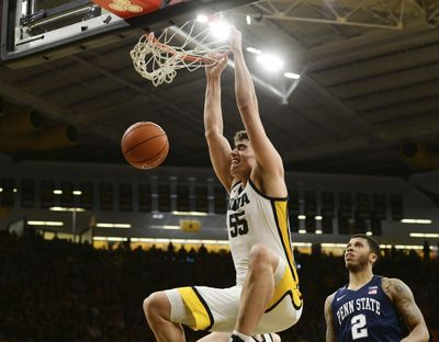 Iowa's Luka Garza (55) dunks the ball as Penn State's Myles Dread (2) looks on during the second half of an NCAA college basketball game on Feb. 29, 2020, in Iowa City, Iowa.  (Associated Press)