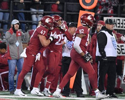 Washington State  safety Skyler Thomas (25) celebrates after his interception  against Cal during the second half Nov. 3 at Martin Stadium in Pullman. WSU won  19-13. (Tyler Tjomsland / The Spokesman-Review)