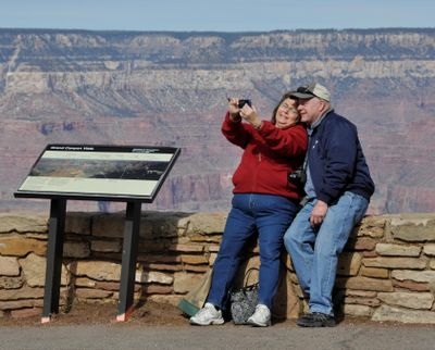 Tourists take a 'selfie' from the South Rim of Grand Canyon National Park. (Rich Landers / The Spokesman-Review)
