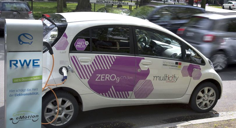 An e-car is connected with a public charge base in Berlin, Germany, April 27, 2016. Germany plans to subsidize electric cars in a bid to help the country's auto industry compete in the global market for the growingly-popular and environmentally friendly vehicles. (AP Photo/Michael Sohn)