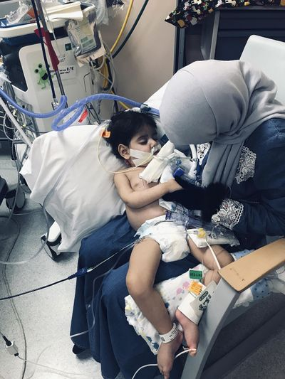 In this Wednesday, Dec. 19, 2018, photo released by the Council on American-Islamic Relations, Sacramento Valley, Shaima Swileh holds her dying 2-year-old son Abdullah at a hospital in Oakland, Calif. (Associated Press)