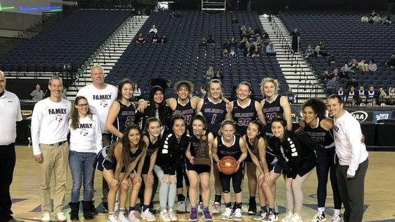 Mt. Spokane girls basketball poses with State 3A fourth-place trophy at Tacoma Dome on Saturday, March 7, 2020. (Dave Nichols / The Spokesman-Review)