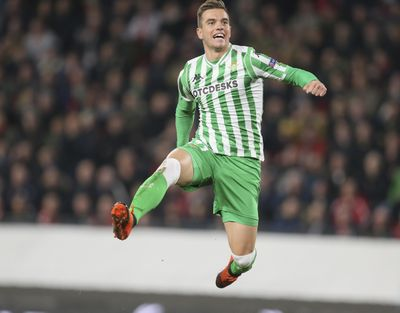 In this Thursday, Feb. 14, 2019 photo, Betis' Giovani Lo Celso celebrates after scoring his side's first goal during the Europa League round of 32 soccer match between Rennes and Real Betis at Roazhon Park stadium in Rennes, western France. Tottenham made the biggest moves on the Premier League's transfer deadline day as it signed winger Ryan Sessegnon and midfielder Giovani lo Celso. Lo Celso has joined on a year-long loan from Real Betis with the option to make the transfer permanent. (David Vincent / Associated Press)