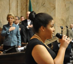 OLYMPIA -- Sofia Smith, 15, of Seattle, sings the National Anthem before Gov. Chris Gregoire delivers her State of the State speech.