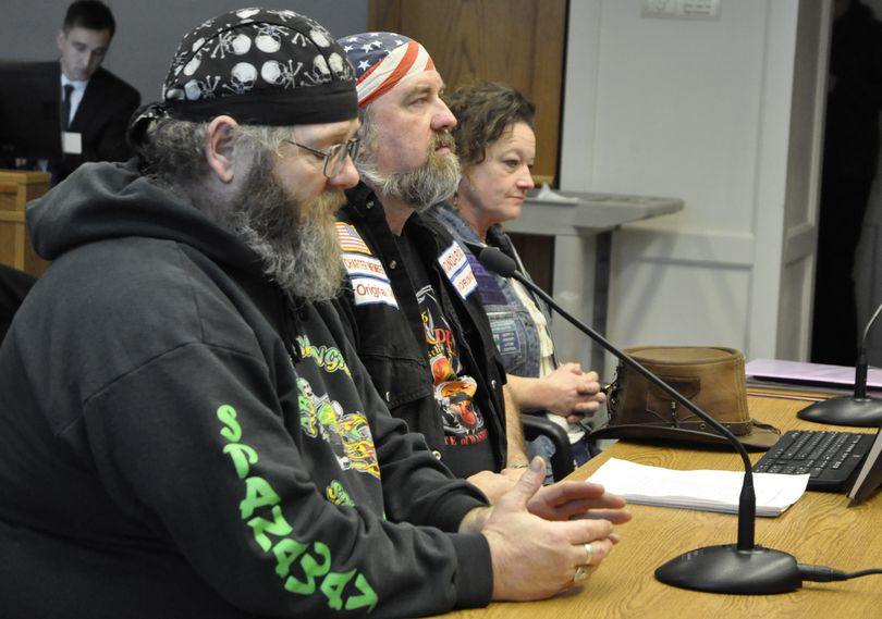OLYMPIA -- Joe Sullivan (left), Keith Parkison and Rachel Ahola, Members of the motorcyclists' rights group ABATE ask the Senate Transportation Committee to make wearing a helmet optional. (Jim Camden/The Spokesman-Review)