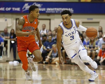 Duke guard Tre Jones  tries to dribble around Auburn guard Bryce Brown  during the first half Tuesday at  the Maui Invitational  in Lahaina, Hawaii. (Marco Garcia / AP)