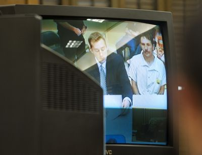 Robert Ruth, who is accused of helping Charles Wallace, is seen on a closed-circuit courtroom television in June in Spokane County Superior Court. (Tyler Tjomsland)