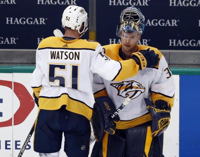 Nashville Predators' Austin Watson (51) taps goaltender Pekka Rinne, right, on the shoulder as they stand by the bench following their 2-1 overtime loss to the Dallas Stars in Game 6 of an NHL hockey first-round playoff series in Dallas, Monday, April 22, 2019. (Tony Gutierrez / Associated Press)
