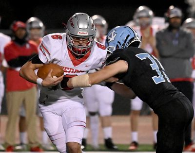 Ferris quarterback Paxton Page (6) is sacked for a loss by Central Valley linebacker San Cann (31) during the first half of a high school football game, Friday, Sept. 17, 2021, at Central Valley High School.  (Colin Mulvany/THE SPOKESMAN-REVIEW)