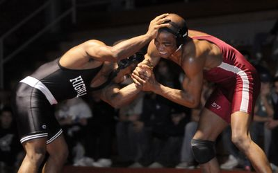 NIC's Lester Brown, right, avenged two earlier losses to Highline's Aaron Smith to capture the 133-pound championship. (Jesse Tinsley / The Spokesman-Review)
