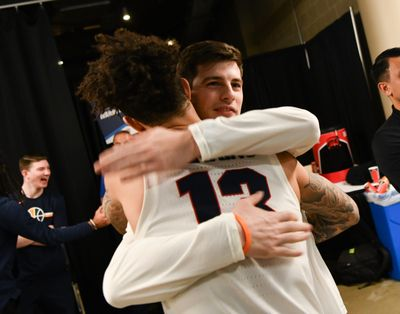 Baylor grad assistant Rem Bakamus (right) hugs former Gonzaga teammate Josh Perkins before the Zags routed Fairleigh Dickinson at the 2019 NCAA Tournament in Salt Lake City. The Zags defeated Baylor 83-71 two days later in the second round.   (Tyler Tjomsland/The Spokesman-Review)