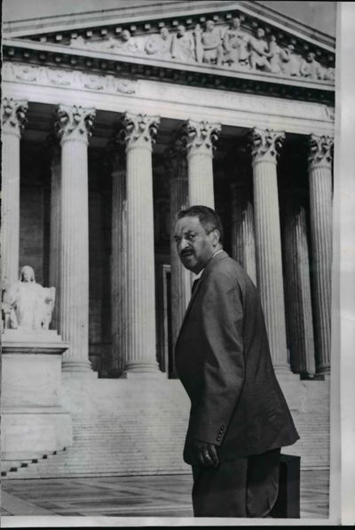 Thurgood Marshall, attorney for the National Association for the Advancement of Colored People, is shown arriving at the U.S. Supreme Court in Washington, D.C., in 1958 to file papers.  (AP (Associated Press))