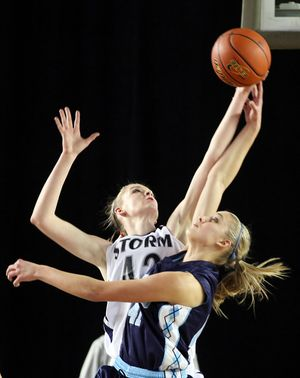 Central Valley's Madison Hovren, right, battles Skyview's Katie Swanson for a rebound. (PATRICK HAGERTY)