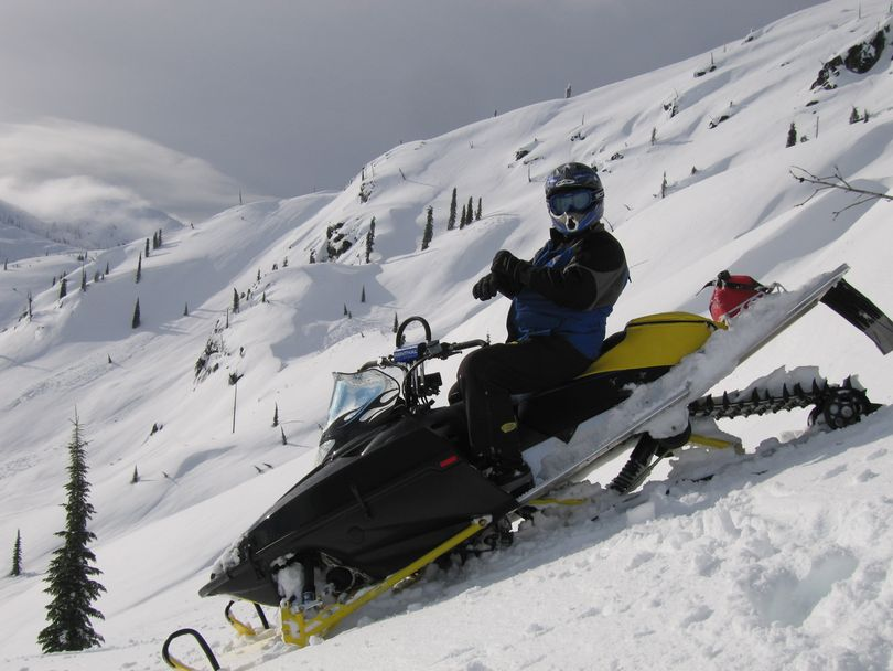 Following snow covered Forest Service roads snowmobilers gain elevation and access to outstanding off-trail powder, terrain, snow bowls, and scenery. (Craig Hill)
