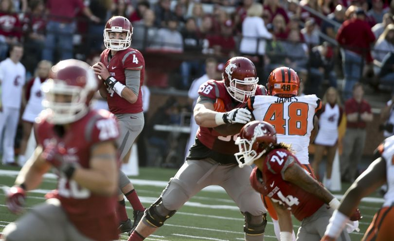 WSU quarterback Luke Falk he's thrown for 16 touchdowns and averaged 7.7 yards per pass attempt over the last three games for the Cougars. (Tyler Tjomsland / The Spokesman-Review)