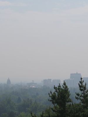 Things are looking a bit brighter in Boise on Friday afternoon, Sept. 8, 2017, but the skyline still is shrouded in smoke. A statewide air quality alert was lifted Friday morning due to improvements in eastern Idaho, but much of the state still is under a heavy pall from wildfire smoke, and regional restrictions on open burning remain in effect. (Betsy Z. Russell)