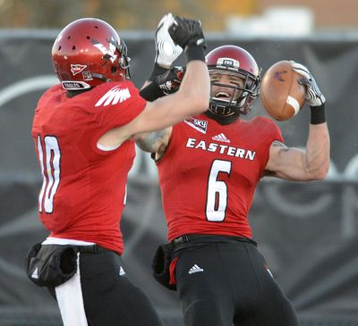 EWU wide receiver Cory Mitchell, right, celebrates a touchdown catch in last year's playoffs with fellow receiver Cooper Kupp. (Colin Mulvany)