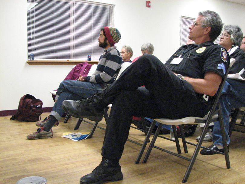 Spokane Police Sergent Dennis Walter and Brian Estes of the South Perry Farmers Market listen to Mayor Mary Verner's presentation at the South Perry Business and Neighborhood Association's annual meeting on Oct. 12. The meeting was held at the Emmanuel Life Center. (Pia Hallenberg)