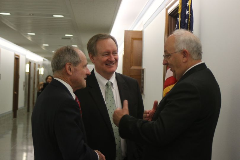 Judge David Nye, left, talks with Sens. Jim Risch, left, and Mike Crapo, center, outside the Senate Judiciary Committee's hearing room on Tuesday