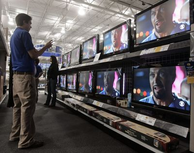 Home theater salesman Justin Standish, left, helps a customer pick a flat-screen television at a Best Buy in Nashville, Tenn.  (Associated Press / The Spokesman-Review)