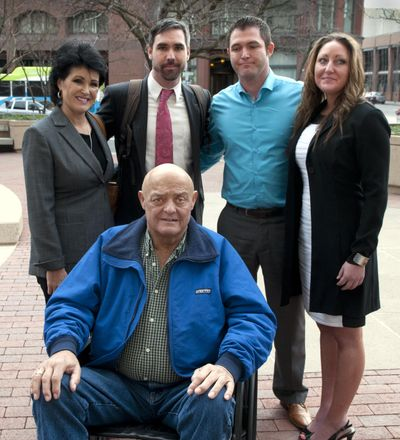 In this Feb. 12, 2015, file photo, Larry Harvey is seated in front of, from left to right, Rhonda Lee Firestack-Harvey, Jason Zucker, Rolland Gregg and Michelle Gregg outside the Thomas S. Foley United States Courthouse, in Spokane, Wash. The Justice Department has dropped its case against Harvey, 70, who was charged in a northeastern Washington marijuana grow after he was diagnosed with late-stage pancreatic cancer. Harvey faced federal charges, as did his wife, two other relatives and a family friend, after they were caught growing about 70 pot plants on their rural, mountainous property near Kettle Falls. (Dan Pelle / The Spokesman-Review)