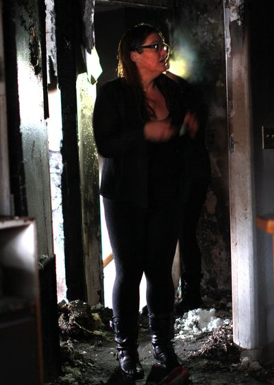 Shelly Shaw, a resident of Sojourners' Alliance in Moscow, Idaho, surveys fire damage at the men's transitional house on Tuesday, Dec. 19, 2017. (RACHEL SUN / For The Spokesman-Review)
