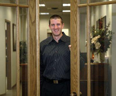 Now: New doors opened recently for former Gonzaga star Matt Santangelo, who returned to Spokane to work at Summit Capital.   (Dan Pelle / The Spokesman-Review)