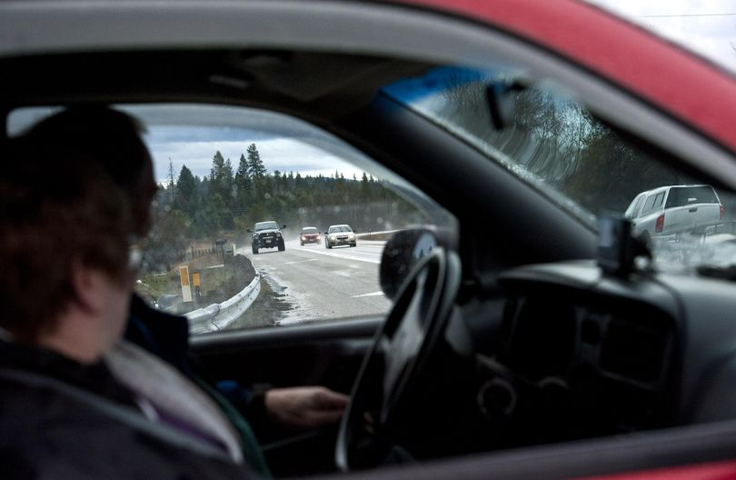 A driver waits to turn onto U.S. Highway 95 where the four-lane freeway ends, just south of the Kootenai-Bonner county line on Friday, April l7, 2017. That stretch of road is one of two major construction projects on U.S. 95 in North Idaho that are top candidates to get funded from the big transportation bill that Idaho lawmakers passed, which includes $300 million in new highway bonding. (Kathy Plonka / The Spokesman-Review)