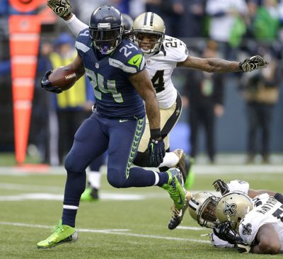 Running back Marshawn Lynch rushed for Seattle playoff-record 140 yards. (Associated Press)
