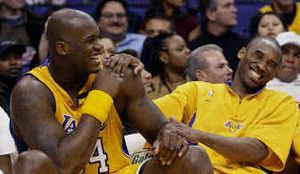 Shaquille O'Neal, left, and Kobe Bryant shared a laugh on the Lakers' bench last season during a game against the Nuggets.  (Associated Press / The Spokesman-Review)