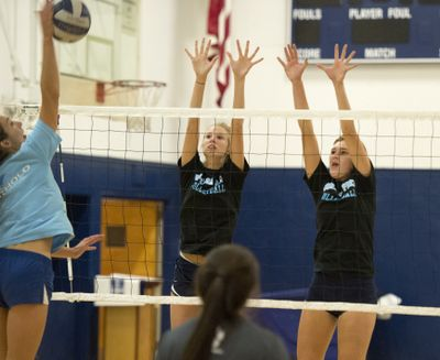 Maddie, center, and Sophie West, right, of Gonzaga Prep are nicknamed the