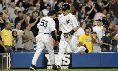 Hideki Matsui trots home after hitting one of Yankees' four eighth-inning home runs.  (Associated Press / The Spokesman-Review)