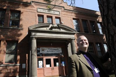Brian Shute, a speech pathologist at Franklin Elementary, stands in front of the school Friday. The school is 100 this year.  (Jesse Tinsley / The Spokesman-Review)