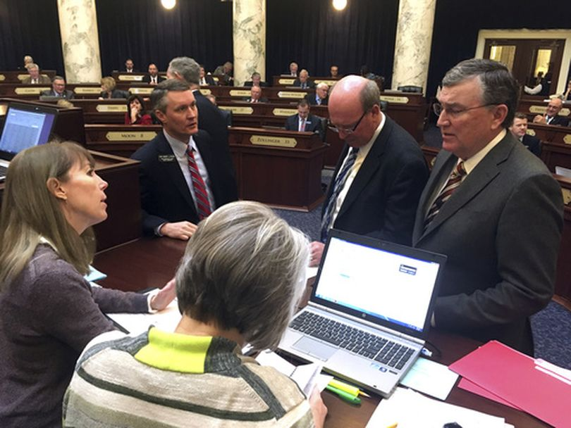 House GOP leaders confer with House clerks during Wednesday's extended debate over an unsuccessful move to call a bill out of committee, over the objections of the committee's chairman. (AP / Kimberlee Kruesi)